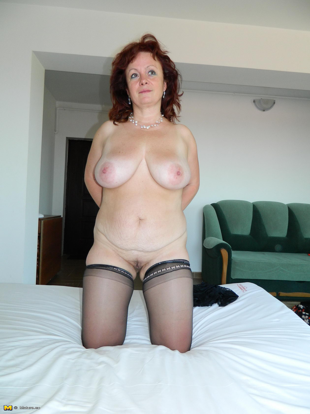 sexy older woman lies in the bed and relaxing - fucking pantyhose pics